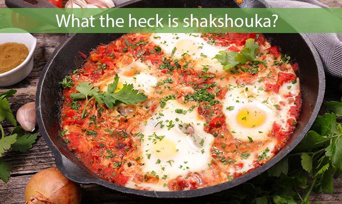 A cast iron skillet with tomato-based sauce and poached eggs.